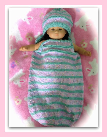 Striped Baby Cocoon With A Matching Hat