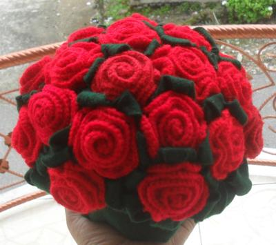 Hand-knitted red roses