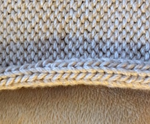 Curled (rolled) edge on a sweater