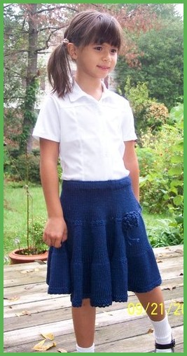 girl twirly skirt in navy blue school uniform