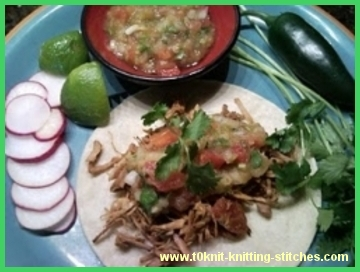 slow cooked pork taco with green salsa