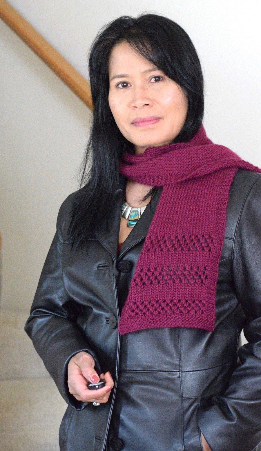 I'm wearing newly made beginner eyelet scarf.